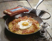 Fried potato with bacon and fried egg